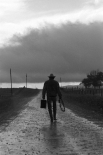 cowboy-walking-in-a-rain-storm-nm